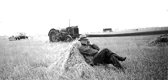 Historical photo of Farmer Nels out in the field
